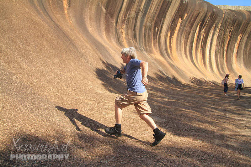John running up wave rock