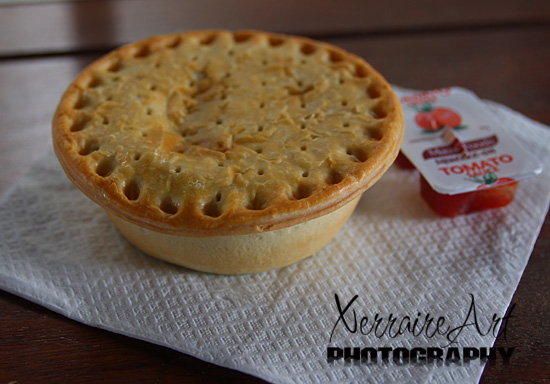 Meat pie and tomato sauce