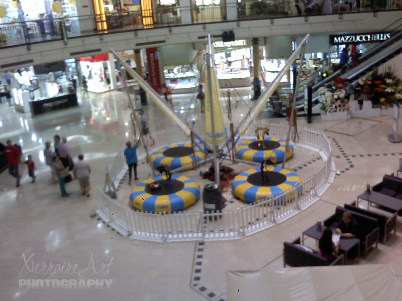 One thing I had to take a quick snap of is this place for children that this mall and some others have. You tie your child in securely and then they can jump high into the air on these trampolines.