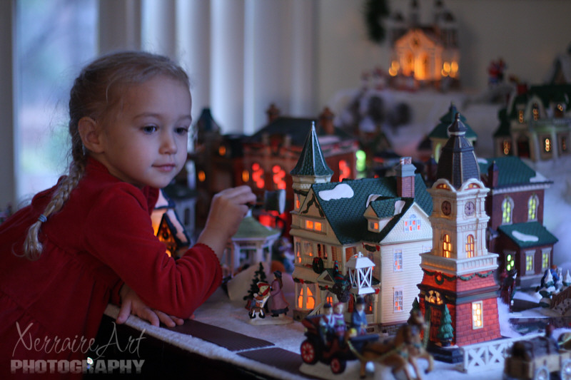 She had fun with the whole Christmas village, too. (Things to be glued back together later!)