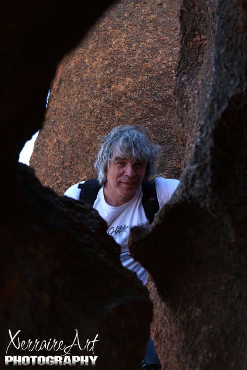 Playing peek-a-boo with John atop Wave Rock amongst the rocks.