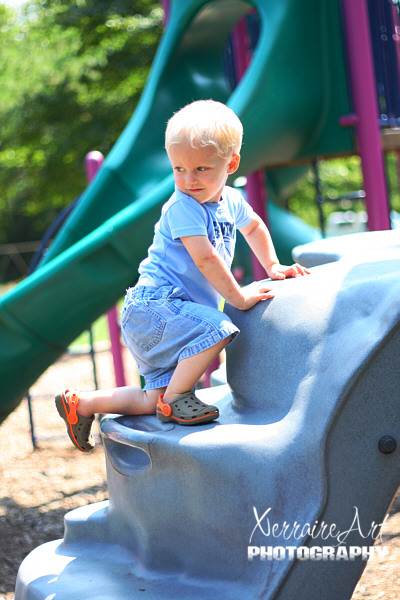 Silas climbing on the playground